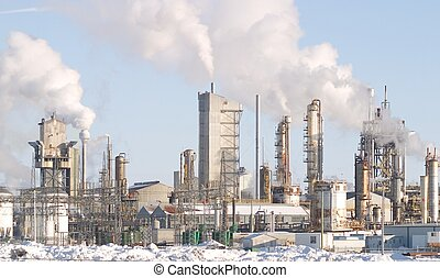 Factory - A factory belching smoke.