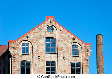 Factory Building and Chimney - Old factory building on clear...