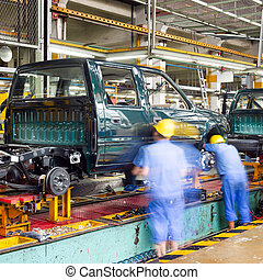 Factory floor, car production lines. - Pickup truck...