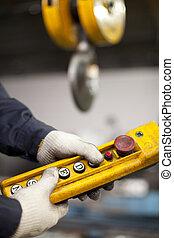 Factory interior crane hook button