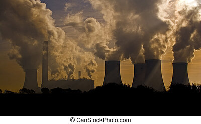 Factory landscape - A factory belching out pollution
