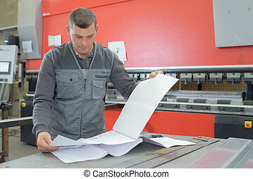 factory man worker checking paperwork