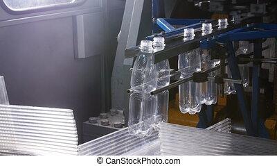 Factory of plastic bottles. Conveyor