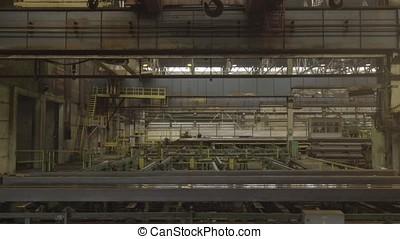 Factory overhead crane. Yellow steel load-lifting hook....