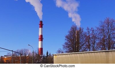 factory pipe smoke - smoke from a chimney factory frosty in...