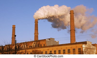 Factory plant smoke stack over blue sky background