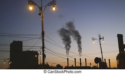 Factory. Plant with pipes from which there is smoke