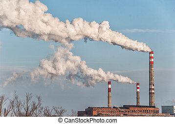 Factory smoke against a blue sky