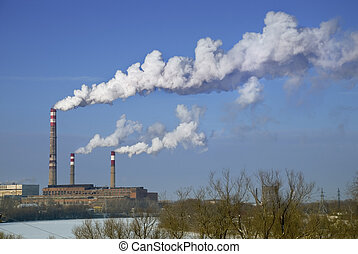 Factory smoke - factory chimneys with white smoke against a...