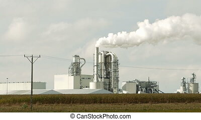 Factory smoke stack and pipes puff into air. Atmospheric air...