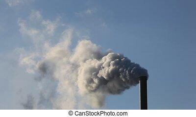 Factory smokestack - Factory smokestack blowing fume into...