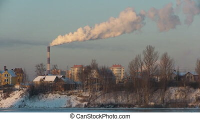 factory with smoking pipe at suburbian