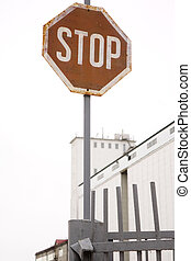 Factory with a stop sign
