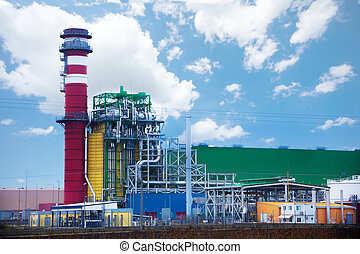 Factory with colorful tower and metallic tubes