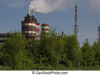 Factory with industrial smoke stacks on nature - Factory...
