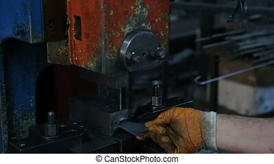 Factory Worker Drilling Metal Parts with a Machine