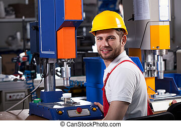 Factory worker during work - Young handsome factory worker...