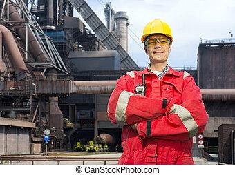 Factory worker in overalls - Factory worker posing in front...