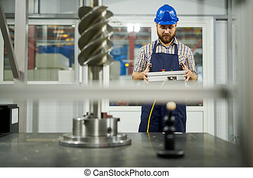Factory Worker Operating Machines