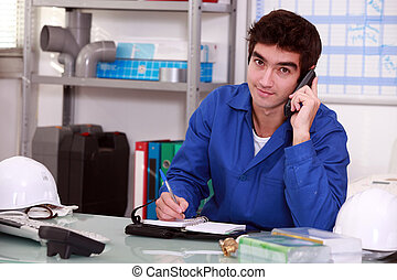 factory worker talking on the phone