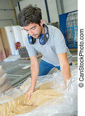 Factory worker with package