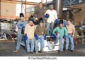 Factory Workers and Supervisor - A group of metal workers...