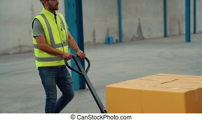 Factory workers deliver boxes package on a pushing trolley in the warehouse . Industry supply chain management concept .