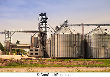 factory yard metal tank of modern silo in countryside