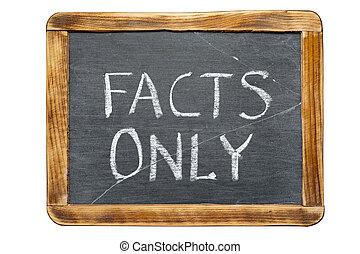 facts only phrase handwritten on vintage school slate board