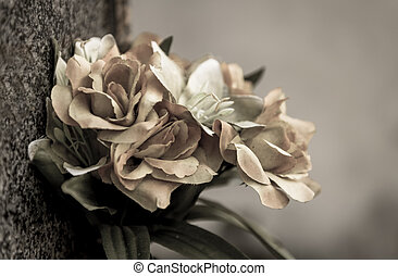 faded flowers - faded artificial flowers on a grave