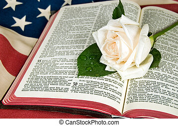 Rose on bible with flag.