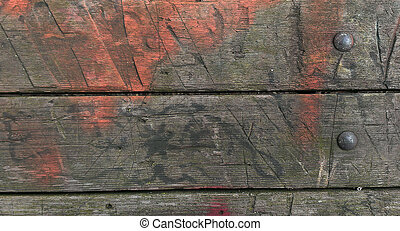 faded orange paint on old wood