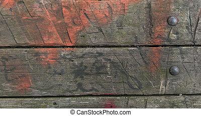 faded orange paint on old wood