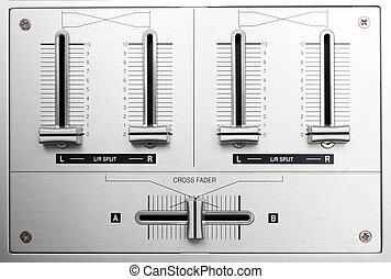 fading controls of dj music mixer close-up