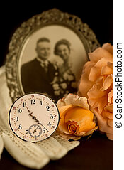 Fading memories - Old wedding photograph, wedding gloves,...