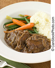 Faggots in Onion Gravy with Mashed Potato and Vegetables