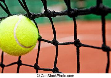 Failure defeat concept - tennis ball in the net - Failure or...