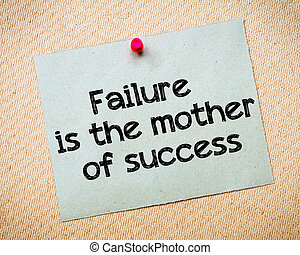 Failure is the mother of success Message. Recycled paper note pinned on cork board. Concept Image