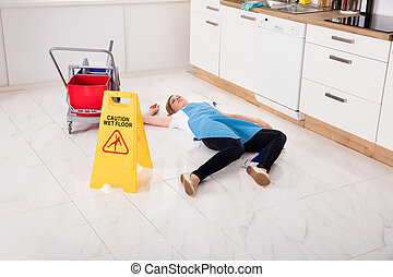 Fainted Housemaid Lying On Floor In Kitchen - Young Fainted...