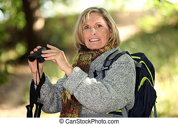 fair-haired elderly woman with binoculars