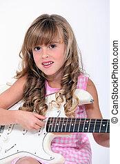 fair-haired little girl playing bass