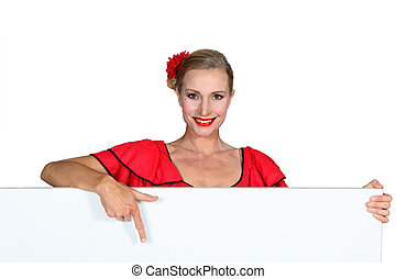 Fair-haired woman showing us a board.