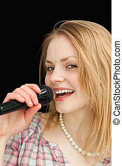 Fair-haired woman singing