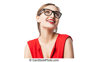 Fair-haired woman with red lips smiling while looking up