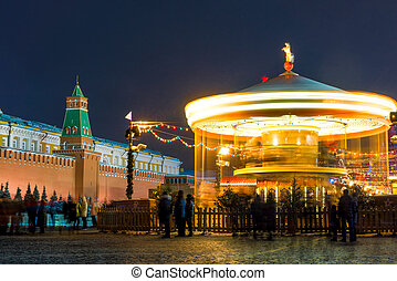 Fair in the center of Moscow near the Kremlin, view of the carousel. Russia, winter