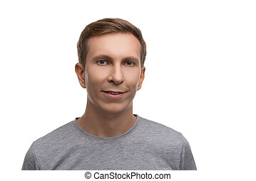 Fair male in gray t-shirt isolated portrait