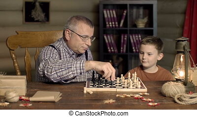 Fair Play - Grandpa happy to capture chess pawn of his...