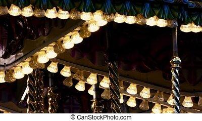 Fairground Ride Lights Closeup - Lights blinking on ride at...