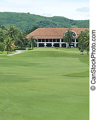 Fairway and clubhouse at a golf course in tropical a...