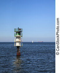 Fairway in a sea - Fairway with green buoy in a sea.